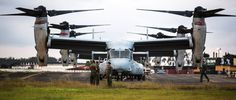 U.S. Marines with Special-Purpose Marine Air-Ground Task Force - Crisis Response - Africa conduct maintenance on MV-22B Ospreys in support of Operation United Assistance in Monrovia, Liberia, Oct. 10, 2014. ANDRE DAKIS/USMC