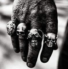 Johnny Cash and his Smiley Face Skull ring.  I've always wanted one.