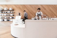 St-Franks-Coffee-by-OpenScope-Studio A curved serving counter clad with a honeycomb pattern of white tiles occupies the front space of this cafe in San Francisco, California