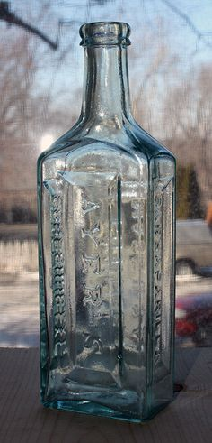 Ayer's Sarsaparilla - Aqua, double ring lip, rectangular, 8 1/2in (218mm) tall. Embossing: AYER'S (down front), SARSAPARILLA (down side), COMPOUND EXT. (down other side), LOWELL / MASS. U.S.A. (down back). Around 1880. Old Medicine Bottles, Old Glass Bottles, Vintage Bottles, Bottles And Jars, Double Ring, National Trust, Tins, Apothecary, Snake