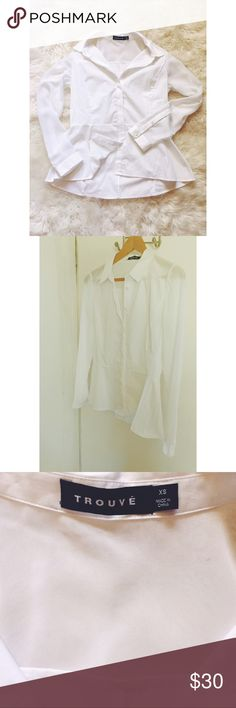 SOLD Trouvé Crisp White Button Up Shirt This is your go-to crisp, white shirt! Absolutely stunning cut and fit. The sleeves are a sheer material and the buttons are covered with fabric down the middle for a sleek line. Bottom half is a slight peplum cut. Gently used. Great condition. Trouve Tops Button Down Shirts