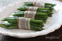 Bacon Wrapped Green Bean Bundles   ~~~   These are really easy to make, I served them as a side with Petite Turkey Meatloaf for dinner, but this would also make an elegant side dish for Easter dinner if you double the recipe. You can prep them ahead of time, then roast them just before serving.  ~~~ NOTE: we alway cook the bacon half way first, that way it does crisp up, and we like our bacon crisp :)