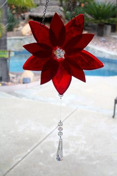 This fused glass suncatcher is beautiful and is The transparent red glass reflects sunlight beautifully