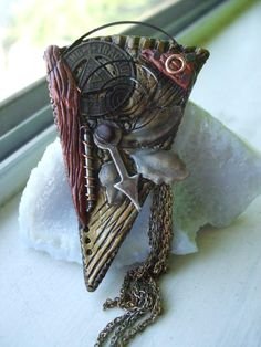 Steampunk Broach    Bedecked with metal parts and an antique1920's transportation token.  Hand crafted by me using polymer clay, baked and painted. SOLD