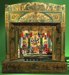 """Tombstone:  Toy, """"Toy Theater"""", 1877–1935.  1877–1935. Wood, paper and cloth; wood, cardboard and printed and colored paper.Toy Theatre-proscenium, Smithsonian, Cooper-Hewitt, National Design Museum    (Double Eureka,,,finally a pic!  2,000 more pages to wade through)"""