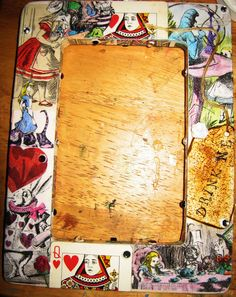 Craft Brat: Alice In Wonderland. Bought and unfinished wood frame and decoupaged it for the party and put a picture of the birthday girl in it