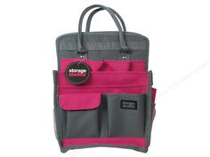 """Storage Studios products help to keep you and your supplies organized and protected in style. Spinning Craft Tote- Features a large, main compartment for oversized items, pockets of varying size to hold tools and supplies, pen loops for journaling pens, markers, and more. Has reinforced handles, and an attachable spinning carousel to easily rotate and retrieve supplies. Hot Pink and Grey canvas on the exterior with Charcoal and White polka dot lining. Measures approximately 10.25""""x ..."""