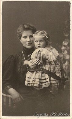 The mother and child are both very beautiful. This is a foreign CdV. The child's plaid dress with the large collar and long bow in the back is really cute!