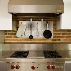 Stainless Steel pegboard can be used for applications beyond garage storage. House, Kitchen Cabinets, Cabinet, Pegboard Kitchen, Home Decor, Kitchen, Metal, Stainless, Garage Storage