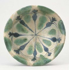 AN ABBASID COBALT-BLUE, GREEN AND GREY TIN-GLAZED POTTERY BOWL, MESOPOTAMIA, 9TH CENTURY