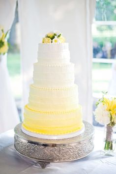 Ombre cake.  Except use cupcakes.  Bride and groom topper would be white.