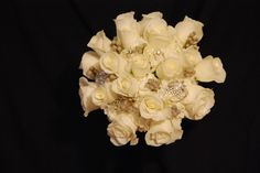 nosegay of white roses, brunni berries, scabiosa pods and white hydrangea.