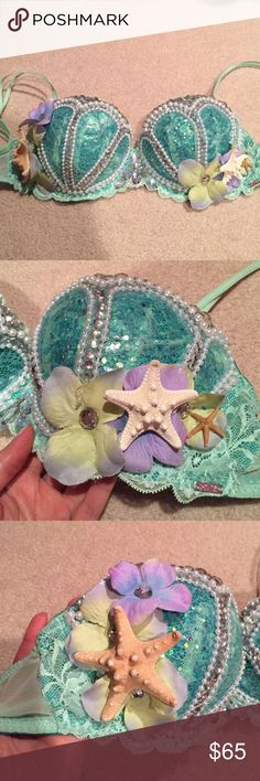 Handmade mermaid rave bra with matching headpiece Handmade rhinestone glitter mermaid bra 32D. One of my favorite bras i ever made! Wore it for EDC Las Vegas and Halloween. Got so many compliments. Beautiful green color with green iridescent glitter glued on. Pearl and rhinestones details to make the shell look. Glued on starfish and flowers with rhinestone accents. Bra is by Victoria's Secret Pink. Comes with the matching handmade headpiece. Little starfish, shells, flowers and rhinestones…