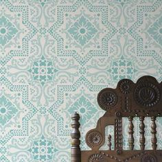 Allover Wall Stencil | Lisboa Tile Stencil | Royal Design Studio, looks like ceiling tiles, sky blue shines through copper patina green