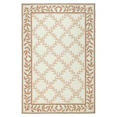 Hand-hooked rug with lattice leaf motif.  Product: RugConstruction Material: Polypropylene and olefinColor: Ivory and beigeFeatures:  Hand-hookedStrong cotton backing Note: Please be aware that actual colors may vary from those shown on your screen. Accent rugs may also not show the entire pattern that the corresponding area rugs have.Cleaning and Care: Professional cleaning recommended