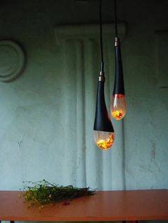 The Alchemist lighting was designed by Sebastian Barlica in 2013, and so far has been installed in public and residential locations. The glass bulbs are hand blown by artisans here in Romania, creating individual and unique shapes each time. #led #light #pendant #lighting #lamp