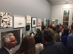 A full house gathers to bid on art at the 2017 Private Collections post-party silent art auction hosted by Simon Breitbard Fine Arts.