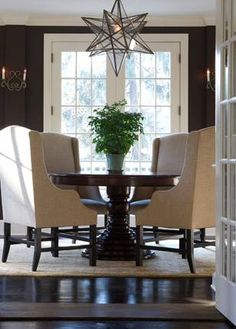 Elegant dining room with chocolate brown walls paint color, French doors, chocolate brown pedestal dining table, camel linen dining chairs and Moravian star pendant. Pedestal Dining Table, Dining Room Table, Dining Rooms, Kitchen Tables, Dining Area, Kitchen Dining, Style At Home, Chocolate Brown Walls, Linen Dining Chairs