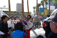 Adrien Brody takes pictures with fans at the 2012 Toyota Pro/Celebrity Race in Long Beach. #TPCR