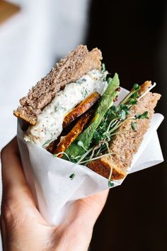 The ultimate stacked veggie sandwich with sunflower seed tzatziki, golden beets, avocado and sprouts!