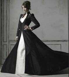 This is interesting and caught my eye.. Gothic black wedding dress. Would never consider wearing it of course but I love the look of this picture