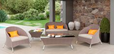 The Renava Zamora 5 PC Outdoor Sofa Set consists of 2 chairs loveseat coffee table and side table with glass top It features aluminum frame and includes four orange throw pillows Excellent craftsmanship with a strong and sturdy construction It is uni. Outdoor Sofa Sets, Outdoor Living, Outdoor Furniture Sets, Brown Furniture, Furniture Ideas, Rattan Sofa, Cushions On Sofa, Brown Sofa Set, Tempered Glass Table Top
