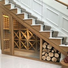 UNDER STAIRS WINE & WOOD STORAGE. Bespoke wine racking for under stairs wine storage, perfect for any home re-design or makeover! Made from hand in the UK using Pine, this wine cellar can store up to 350 bottles. Under Stairs Wine Cellar, Wine Cellar Basement, Space Under Stairs, Bar Under Stairs, Under Basement Stairs, Staircase Storage, Storage Under Stairs, Staircase Design, Home Wine Cellars