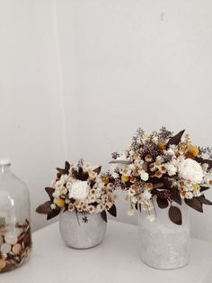 Love the deep maroons and ochres in these dried flower arrangements