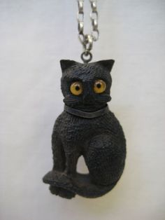 Antique-Irish-Folk-Art-Bog-Oak-Lucky-Cat-with-Glass-Eyes-Pendant-Necklace-Treen