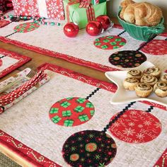 A holiday table to be proud of! Matching table runner quilt pattern, place mat, and napkin ensemble are made to impress. Gather 'Round is so cute and quick, you could also use this FREE pattern trio to make holiday gifts!