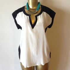 Stunning Perfect black and cream top Stunning perfect cream and black short sleeve top Daniel Rainn Tops