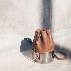 "ELLE UK on Instagram: ""We love some hardware on our bucket-bag list @_persephoni_ @thewolvespr"""