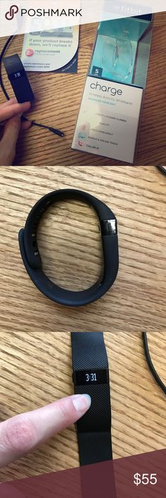 Fitbit charge small-Black Fitbit charge size small, well used but still has lots of life left. Comes with charger and original box. We purchased the 2 year replacement plan on this when purchased at Target, with original purchase date of 9/3/2015, will include the receipt with proof of replacement plan if you would like me to. Make me an offer!☺️ Fitbit Accessories Watches