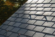 Composite slate roofing gives your the look of a slate roof without the hefty price tag. Read more about it here. Roofing Services, Roofing Contractors, Roof Leak Repair, Types Of Roofing Materials, Diy Roofing, Cool Roof, Slate Roof, Roof Types, House Roof