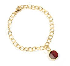 Syna 18 karat yellow gold 7.25 inch bracelet with 10 mm rhodolite garnet (January birthstone) Jewel Chakra charm (stone weight approx. 3.5 cts.).  Available for purchase online at www.leonardojewelers.com and  in our Red Bank, NJ and Elizabeth, NJ stores.