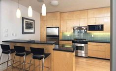 Maple Cabinets with Black Granite by John Donkin