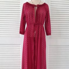 1970's Vintage Burgundy Eyelet Lace Lounge Robe ~1970's Vintage~ ~Lace Lounge Robe ~Excellent Condition The robe is made of sheer nylon eyelet lace, in a rich shade of burgundy wine. neck line and waist are  gathered with black elastic. nylon ties at the neck and waist. trimmed with pretty burgundy scalloped lace. The robe is floor length. It would look great paired with  a black bra and panty set, or a teddy. It would also make a great cover up  for a bikini at the beach. The tag has been…
