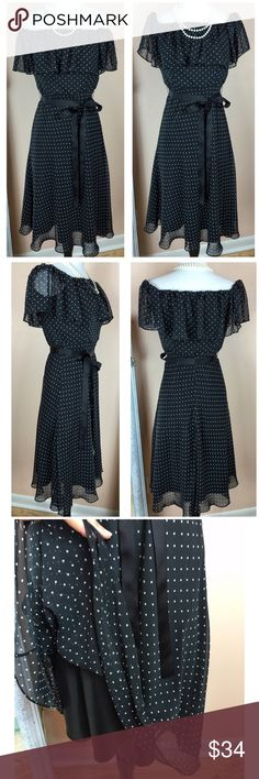 """WHBM Ruffle Pin up polka dot dress White House Black Market Ruffle Pin up polka dot dress Back zip, chiffon overlay, ribbon belt Stunning in person, worn once in perfect condition Made of 100% polyester  Size 4 Bust 17.5"""" across, waist 14.5"""" across, 38.5"""" long  ‼️PRICE FIRM UNLESS BUNDLED‼️ Create a bundle for 15% off! Thanks for looking✌️❌NO TRADES❌ White House Black Market Dresses"""