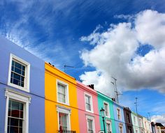 """Portobello Market - home of the antiques market, pastel coloured townhouses and fresh fruit stalls. Hugh Grant wooed Julia Roberts with his foppish stammering in the movie """"Notting Hill"""". His shop was along Portobello Road and all the outdoor  scenes were shot on location. W10 Ladbroke Grove Tube. By JenniPenni on Flickr, 2008."""