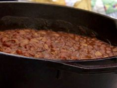 COWBOY BAKED BEANS: 4 cups dry pinto beans 1 pound thick-cut bacon, cut into pieces 2 whole green bell peppers, diced 1 whole onion, diced 1 cup brown sugar 1/4 cup ketchup 2 tablespoons mustard 1 tablespoon chili powder, optional 2 teaspoons salt, more to taste 2 teaspoons black pepper, more to taste 4 cloves garlic, minced