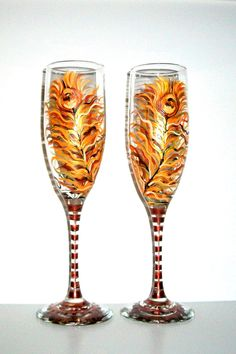 Painted Champagne Flutes Fall Peacock Feathers Hand Painted Set of 2 Fall Wedding, Free Personalization. $45.00, via Etsy.