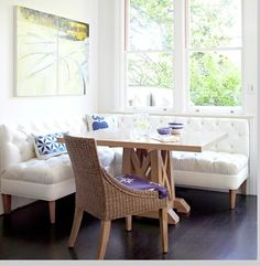 The banquette for east wall could be a free-standing armless upholstered piece, not built-in wood banquette. Benefit would be: greater comfort, no sliding cushions, no under-table wood to kick, flexibility re table placement when seating lots of people. NB