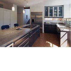 Concrete countertops, black cabinets and cork floors  Rod Collins Construction, Little Rock architect and custom home builder
