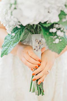 "this bride pinned her sorority sisters' membership pins to her bouquet as her ""something borrowed""!  So sweet!"