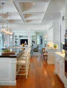 Traditional White Kitchen. Traditional White Kitchen Design. #Traditional #WhiteKitchen. Kitchen Countertop Ideas: The island counter is mahogany with a custom stain and the perimeter countertop is Caesarstone.