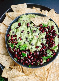 Festive pomegranate guacamole, perfect for holiday parties or as a snack! - cookieandkate.com