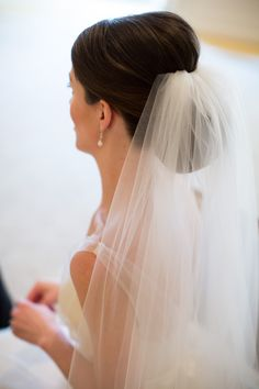 Gorgeous and chic up-do with veil. View the full wedding here:http://thedailywedding.com/2016/06/11/refined-downtown-chicago-wedding-kelley-zach/