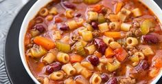 Olive Garden Slow Cooker Pasta Fagioli      1 lb extra lean ground beef (browned and drained)     1 cup chopped onion     1 cup carrots (chopped)     1/2 cup chopped celery     15 ozs diced tomatoes in juice     15 ozs kidney beans (rinsed and drained)     15 ozs white beans (rinsed and drained)     4 cups beef broth ? Tasty tip     26 ozs marinara sauce     11/2 tsps oregano     3/4 tsp hot pepper sauce (such as Tabasco)     1/2 tsp salt     1/2 tsp black pepper     11/4 cups dry pasta (I…