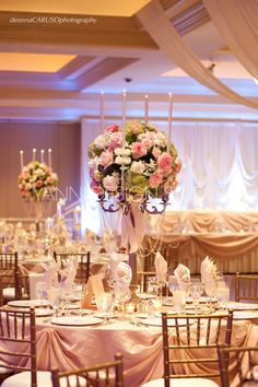 An exquisite candelabra floral centerpiece is quite the attention getter #exquisite #candelabra #floral
