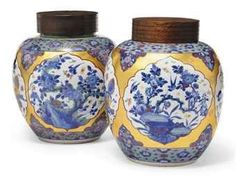 A matched pair of chinese blue and white 'clobbered' jars, 18th century, the enamelling later.